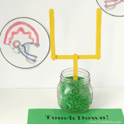 Football centerpiece idea for football party paper football field goal posts.