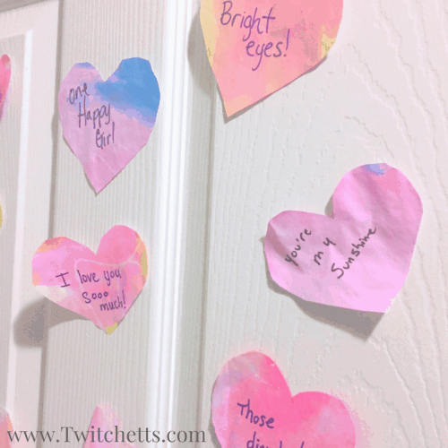 This Valentine's craft is a fun preschool craft. These watercolor hearts make the perfect prop for a fun Valentine's activity for the whole family.