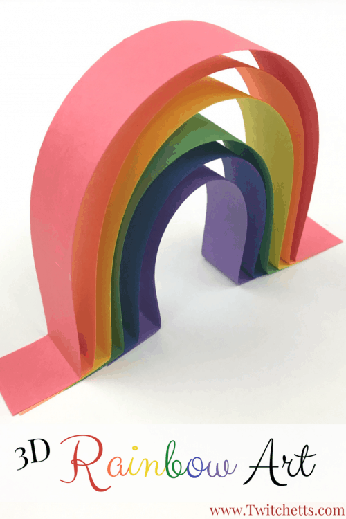 Rainbow Art made from construction paper. These easy construction paper crafts for kids will help teach your child to wait for the glue to dry. Learn how to make a rainbow with construction paper. An amazing 3D rainbow craft. #3drainbowart #rainbowcraft #artforpreschoolers #constructionpapercraftsforkids #rainbow #teachrainbows #kindergartenartproject #twitchetts