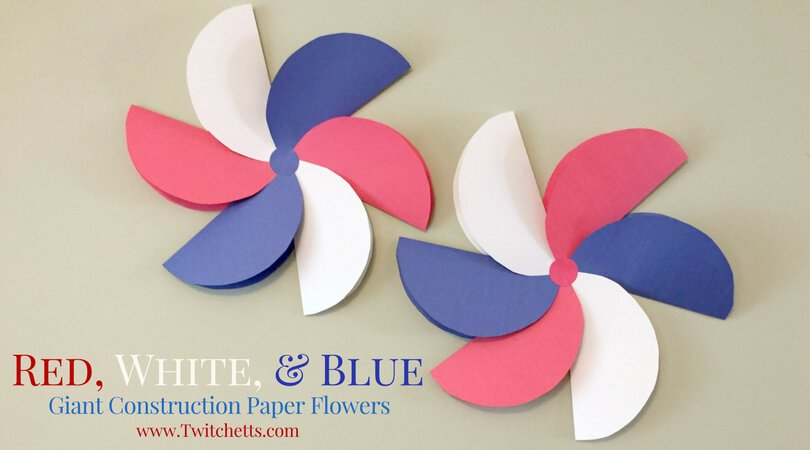 Create these amazing giant construction paper flowers in red white and blue. They are perfect patriotic crafts for kids.