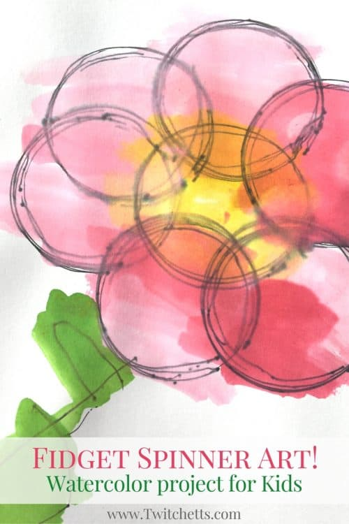 Create watercolor circles by placing a pen inside a fidget spinner hole. This fidget spinner art can be completed by kids of all ages! It's a fun process art that will be different every time.
