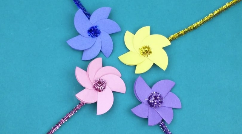 Create these fun construction paper flowers with your little one! Threading on the pedals is great fine motor practice and your finished flower will be fun to hand out!