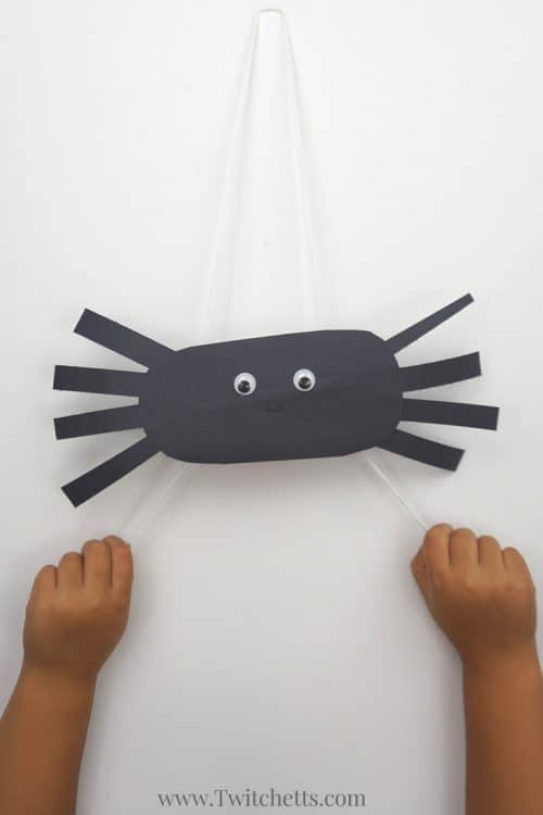 Create Climbing Construction Paper Spiders PIN2 construction papers spiders using black construction paper. A fun Halloween kids craft that they can play with when they're finished!