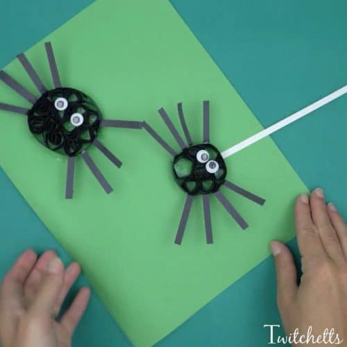 Construction Paper quilling spiders using black construction paper.