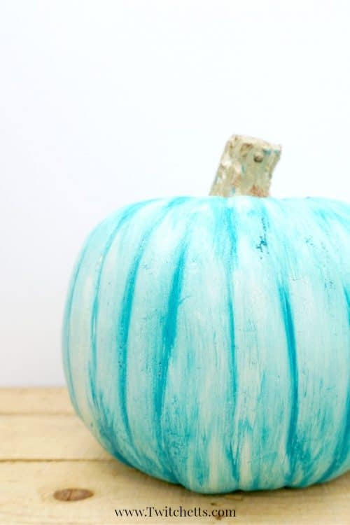 Fun teal painted plastic pumpkin to place on your porch this Halloween season. The first of this year's teal pumpkin ideas!