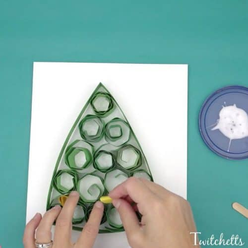 Try this quilling Christmas tree for a fun beginner quilling project that kids will love! This paper Christmas tree is made with construction paper, so it's a fun and inexpensive Christmas craft for kids.