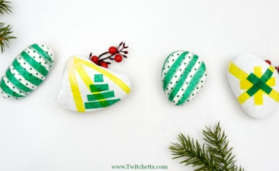 Create these beautiful tissue paper Christmas rocks to give as fun DIY holiday gifts or to hide around your neighborhood!
