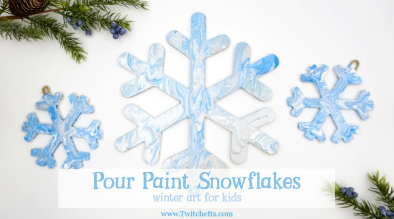 These pour painted snowflake decorations are the perfect winter art project for kids.