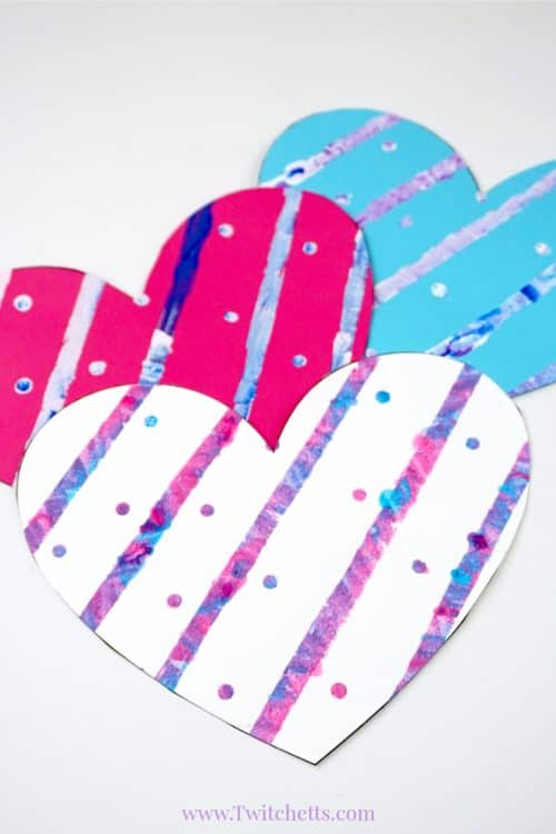 Grab some construction paper and let's create a painted heart! This easy and fun Valentine's Day craft will make beautiful cards, festive decor, or just a fun afternoon project!