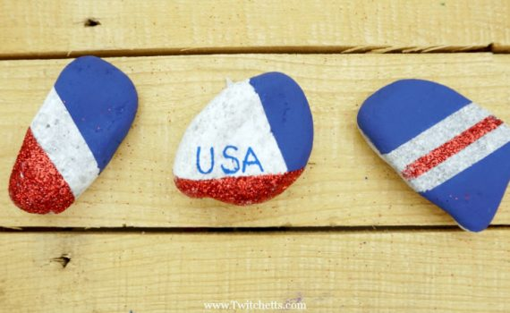 Create these amazing patriotic rocks that sparkle and shine with pride. This rock painting idea for kids is perfect for hiding around town and showing off those red, white, and blues.