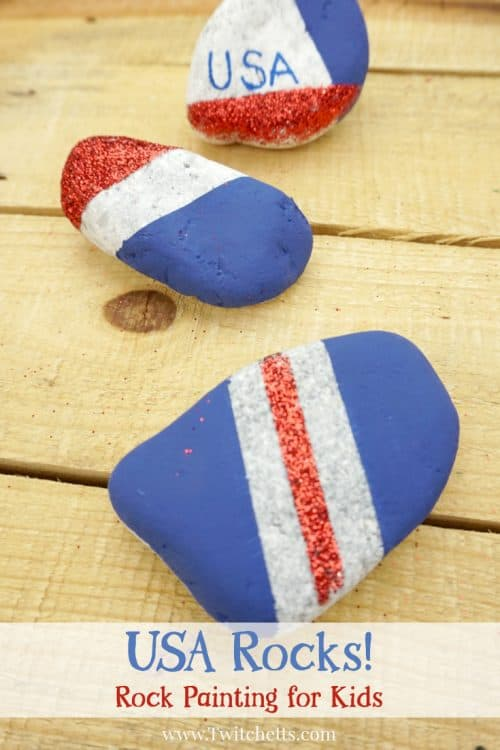Create these amazing patriotic rocks that sparkle and shine with pride. This rock painting idea for kids is perfect for hiding around town and showing off those red, white, and blues. #patrioticrocks #4thofjuly #independenceday #usa #america #rockpaintingideasforkids #glitter #craftsforkids #artprojectsforkids #twitchetts