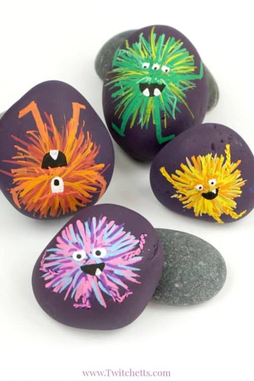 Make these adorablemonster rocks with your kids and some simple rock painting supplies! They are perfect for an afternoon of crafting or a fun Halloween craft. #monsterrocks #rockpaintingideasforkids #halloween #monsters #rocks #stones #poscapaintpens #twitchetts