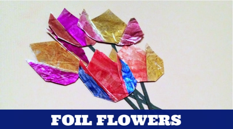 This aluminum foil craft idea is perfect for kids to create and place on cards, posters, or wrapping paper. Decorate the foil to make it colorful and fun. Then fold it into simple flowers.