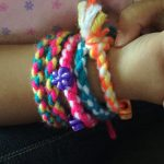 """Image of friendship bracelet made with yarn. Text reads """"Easy Friendship Bracelets-Crafts for kids"""""""