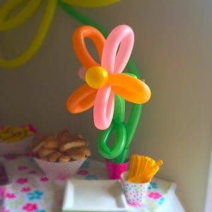 Summer Themed Birthday Celebration. Lots of fun party ideas! Balloon Flowers!