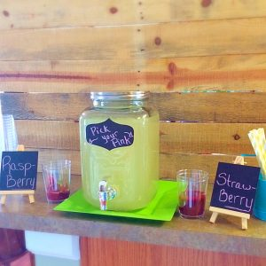 Refreshing pink lemonade station. Summer party drink station. Let your guests pick their flavor of lemonade.