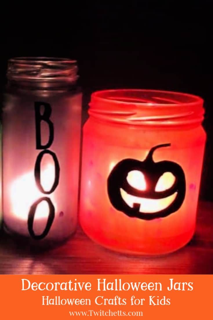 These decorative Halloween jars are easy and fun to make. Kids will love helping to create these recycled Halloween decorations!  #twitchetts