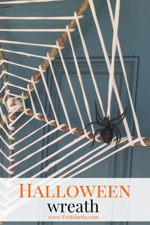 Create this amazing spider web wreath that's perfect for decorating your front door this Halloween. It's quick to create and uses simple supplies! Check out the whole tutorial and have the cutest door on the block! #spiderweb #wreath #halloween #spiderwebwreath #upcycled #sticks #halloweendecor #porchdecor #twitchetts