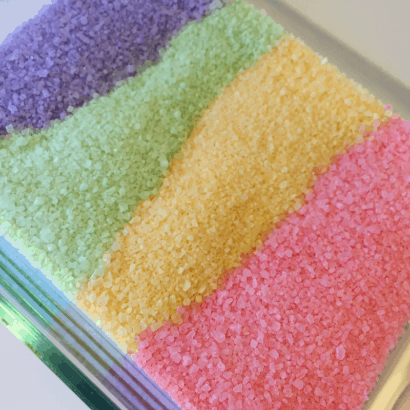 This fun colored salt can be used for sensory play or fun kids crafts. This is a quick toddler activity and the older kids enjoy playing in it too!!