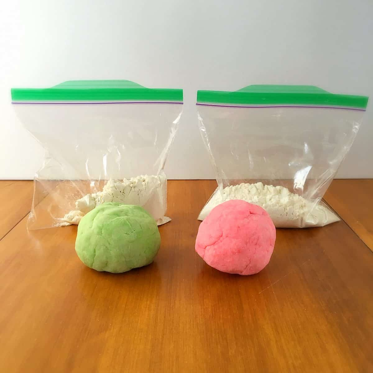 Create these fun homemade playdough packs. They can be made ahead of time and pulled out in a pinch. Plus they contain a fun color surprise!