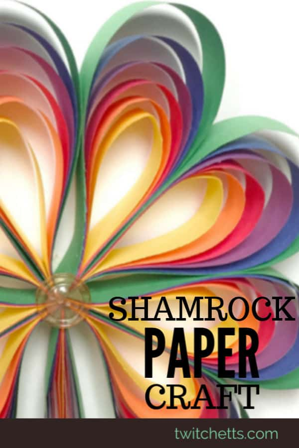 Rainbow colored paper shamrock craft for kids. Grab some construction paper and lets create this fun 3D St Patrick's Day craft. It's perfect for decorating for a St Patty's party! #twitchetts