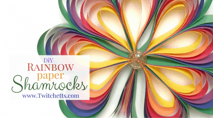 3D rainbow-colored paper shamrocks