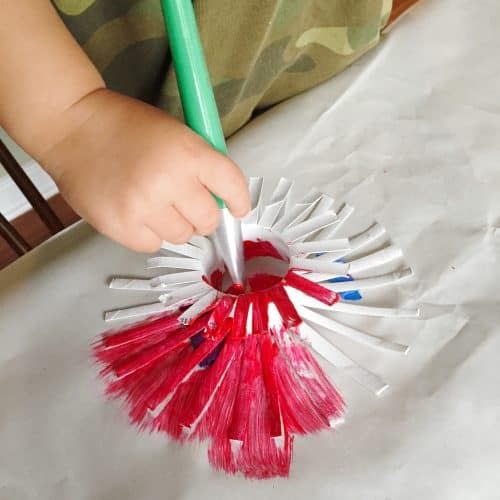 These paper firecracker crafts are the perfect kids craft for the 4th of July. Could be used as party decor or just as a fun activity for the kids. These are set up for cake decoration. Could be a fun Independence day or Memorial Day table decor!