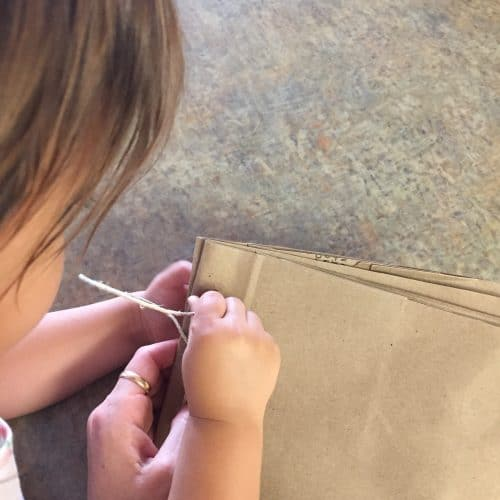 Step by Step instructions to create a fun bag book. Recycle a Brown Paper Grocery Sacks to create these easy DIY books! This is a fun toddler activity or kids craft for all ages.