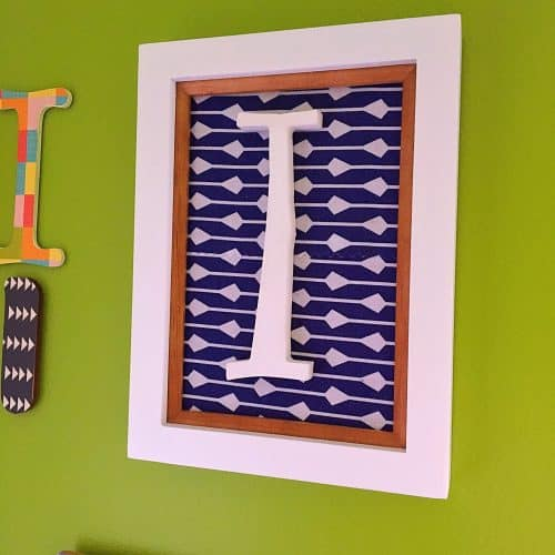Initial Wall Collage-Fabric and a white letter.