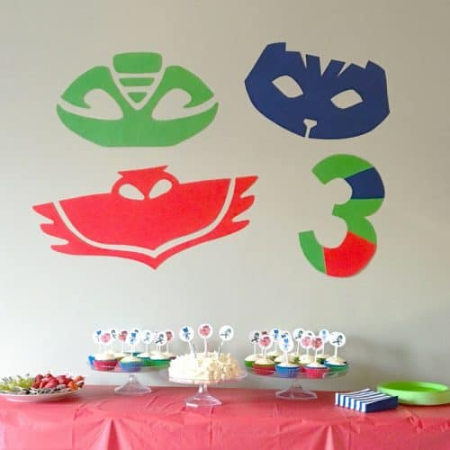 An overview from a 3 year old's birthday party. This PJ Mask party idea was a blast! So many fun ideas for food, decorations, party favors, an activity, and more!