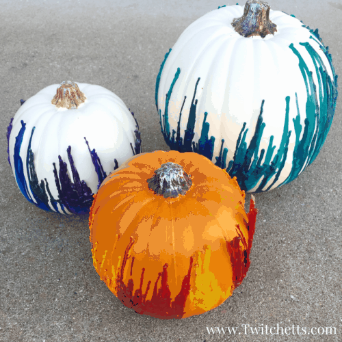 Make fun melted crayon pumpkins, but give them an unexpected twist! This Halloween craft is perfect for kids and adults. Make fall decorations that wow! #meltedcrayon #pumpkin #halloween #fall #tealpumpkin #craftsforkids #twitchetts