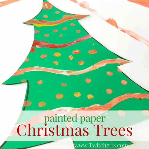 Young kids will love making these painted Christmas trees. With a simple template, your kids can create fun and colorful pieces of Christmas art. #christmastree #christmasart #preschool #kindergarten #artforkids #twitchetts