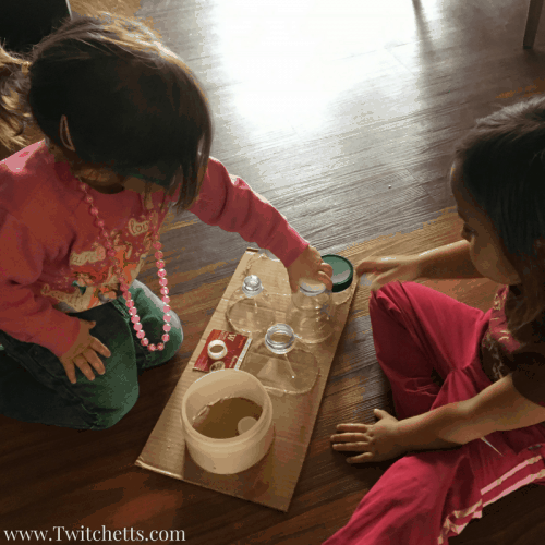 Fine motor activities for kids using plastic bottles. Create a preschool busy board using recycled water bottles.