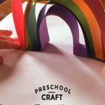 """Image of child making a paper rainbow. Text reads """"Preschool Craft - 3D paper rainbow"""""""