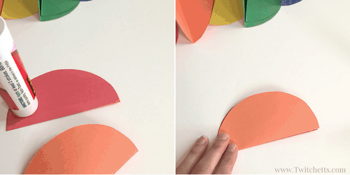 Rainbow Spheres construction paper crafts for kids. These paper spheres are fun to make and cute to have hanging around.