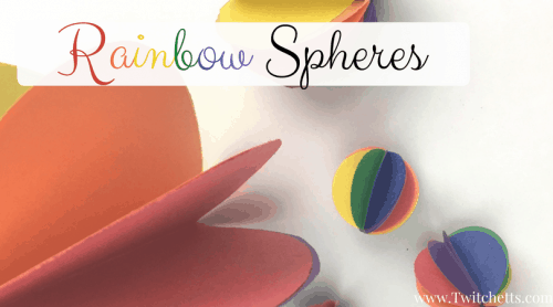 """Image of paper spheres. Text Reads """"Rainbow Spheres"""""""
