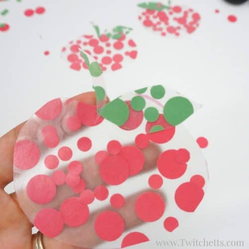 A simple apple themed fine motor activity combines construction paper and contact paper to create a fun apple craft. This activity for preschoolers is perfect for fall, back to school, or teacher appreciation.