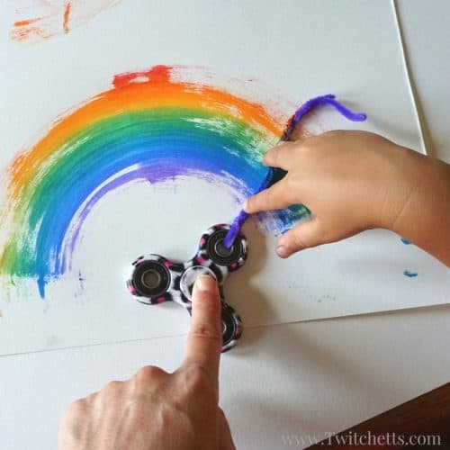 Fun fidget spinner rainbows are an amazing process art. Painting with a fidget spinner is a fun and creative way to use your hand spinner for art.