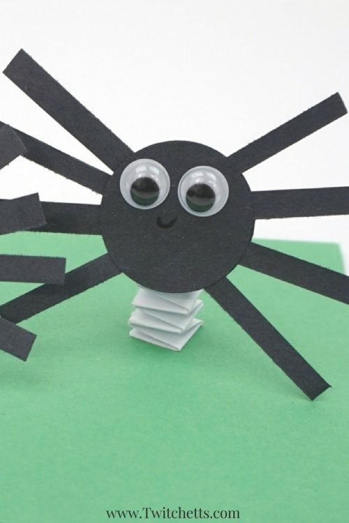 Bouncy construction paper spiders that use up some of your black construction paper. These are fun Halloween crafts for kids. #halloween #paperspiders #spidercraft #craftsforkids #constructionpapercrafts #twitchetts