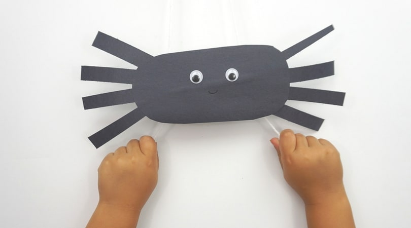 Create climbing construction papers spiders using black construction paper. A fun Halloween kids craft that they can play with when they're finished!