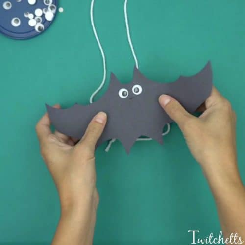 Flying Construction Paper Bats ~ Halloween Crafts for Kids. Create flying construction paper bats using black construction paper and toilet paper tubes. This simple craft will lead to kid-approved Halloween bat decorations.