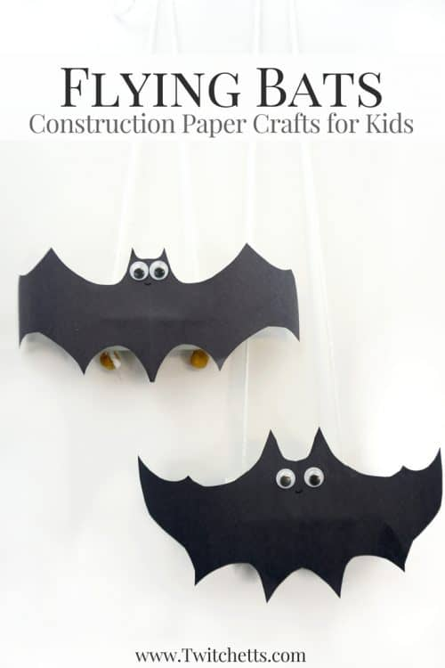 Flying Construction Paper Bats ~ Halloween Crafts for Kids. Create flying construction paper bats using black construction paper and toilet paper tubes. This simple craft will lead to kid-approved Halloween bat decorations. #bats #flyingbats #paperbats #halloween #blackconstructionpaper #batcraft #halloweencraft #constructionpapercraftsforkids #paperfun #halloweenforkids #twitchetts