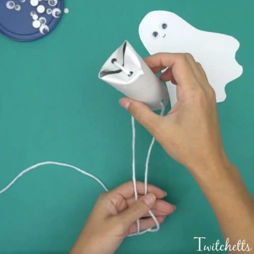 Create flying construction paper ghosts using white construction paper and toilet paper tubes. This simple craft will lead to fun kid approved Halloween ghost decorations.