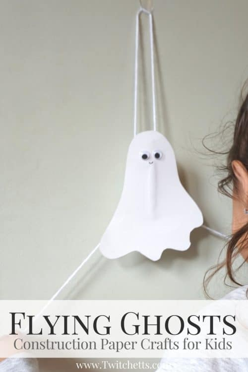 Create flying construction paper ghosts using white construction paper and toilet paper tubes. This simple craft will lead to fun kid approved Halloween ghost decorations. #ghost #paperghost #flyingghost #halloween #craftsforkids #constructionpaper #twitchetts