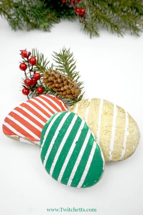 Creating these beautiful Christmas striped stones is easier than you think! This easy rock painting idea is perfect for kids or beginners.
