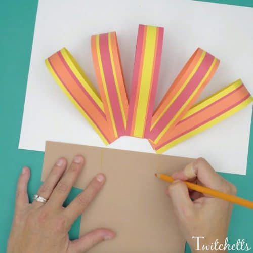 This easy paper turkey is a fun and cute Thanksgiving construction paper craft for kids!