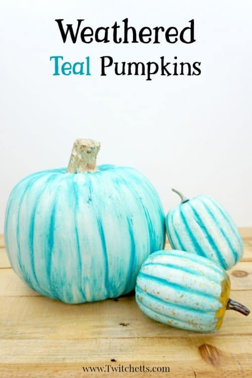Fun teal painted plastic pumpkin to place on your porch this Halloween season. The first of this year's teal pumpkin ideas! #teal #pumpkin #decor #paintedpumpkin #paintedplastic #plasticpumpkin #inexpensivedecor #falldecor #halloween #twitchetts