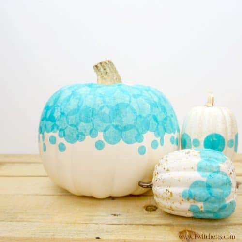 Create a teal tissue paper pumpkin that you can use to decorate your porch this Halloween. Fun teal pumpkin ideas for this year!