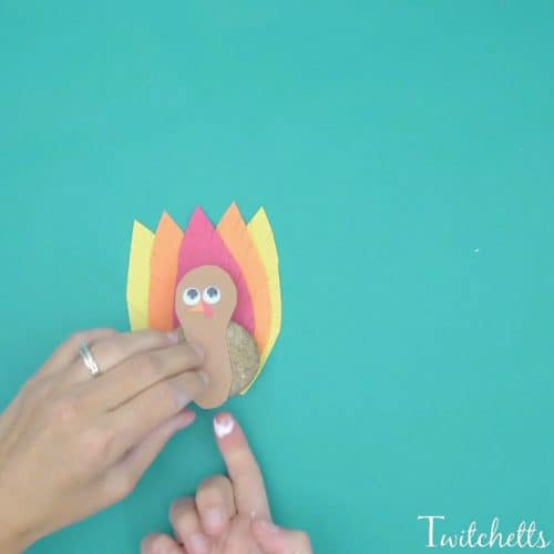A turkey rock craft that is a cute and easy craft for kids.  This fun Thanksgiving craft combines rock decorating with construction paper to create an adorable turkey.