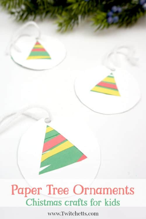 This easy paper Christmas tree ornament is a fun paper cutting craft for those preschoolers who are mastering their cutting skills. Grab some construction paper and some kids' scissors let's create! #papertreeornaments #constructionpaper #christmasornaments #christmascrafts #craftsforkids #classroomcraft #giftsfromkids #twitchetts